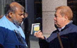 AMERICAN ISLAMIC OUTREACH -Uptown Information table @ intersection Trade St and Tryon St